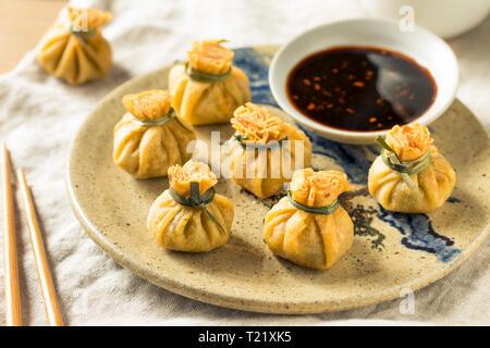 Homemade Deep Fried Shrimp Purse Dumplings with Soy Sauce - Stock Photo