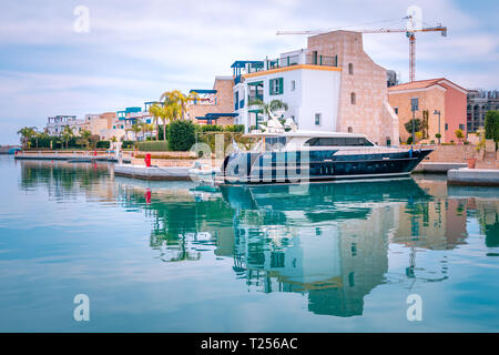 Beautiful view of Marina, Limassol city Cyprus. Modern, luxury life in newly developed port with yachts, restaurants, shops and waterfront promenade. - Stock Photo