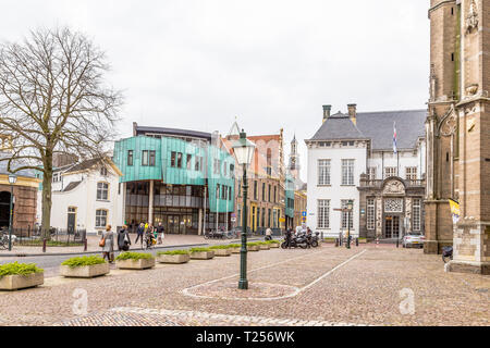 Zutphen, the Netherlands - March 28, 2019: Street view with Walburguis church, city hall and museum in Zutphen in the Netherlands. - Stock Photo