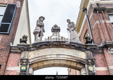 Zutphen, the Netherlands - March 28, 2019: Entrance Bornhof with statues of an old man and woman in the center of Zutphen in the Netherlands. - Stock Photo