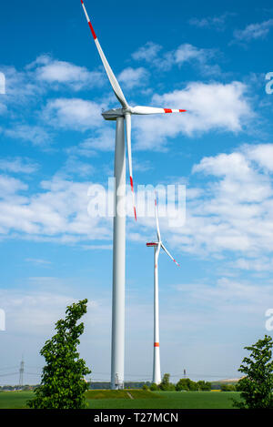 Sustainable energy production with wind wheels seen in Germany - Stock Photo