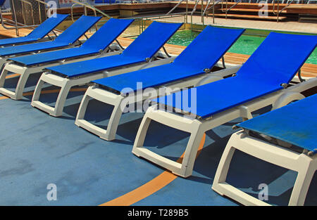 Blue Pool Deck Chairs on a Cruise Ship - Stock Photo
