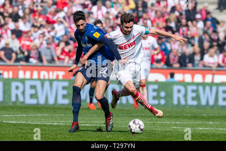 Cologne, Germany. 31st Mar, 2019.  Soccer: 2nd Bundesliga, 1st FC Cologne - Holstein Kiel, 27th matchday in the Rhein-Energie-Stadion. Kiel's Atakan Karazor (l) and Cologne's Jonas Hector fight for the ball. Photo: Guido Kirchner/dpa - IMPORTANT NOTE: In accordance with the requirements of the DFL Deutsche Fußball Liga or the DFB Deutscher Fußball-Bund, it is prohibited to use or have used photographs taken in the stadium and/or the match in the form of sequence images and/or video-like photo sequences. Credit: dpa picture alliance/Alamy Live News - Stock Photo