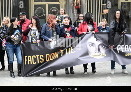Cologne, Germany. 31st Mar, 2019.  Fans protest with posters and signs against the broadcast of the documentary 'Leaving Neverland' about pop star Michael Jackson on April 6th on ProSieben. Photo: Henning Kaiser/dpa Credit: dpa picture alliance/Alamy Live News - Stock Photo