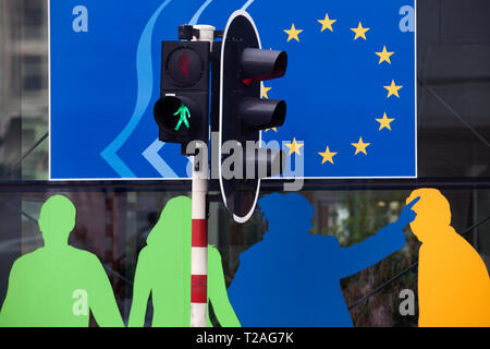 BRUSSELS - Detail of the European economic and Social Committee building with traffic light - Stock Photo