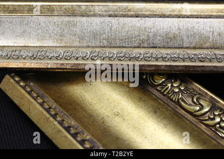 Gorgeous beautiful cornices for the interior samples of decorative finishes gold - Stock Photo