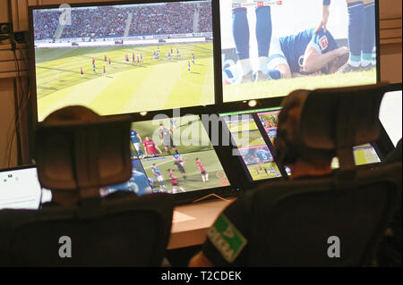 31 March 2019, North Rhine-Westphalia, Köln: Football Bundesliga - video evidence, visit to the Video Assist Center during live football Bundesliga coverage. Video assistants sit in front of their screens. Photo: Henning Kaiser/dpa - Stock Photo