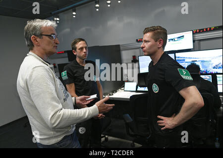 31 March 2019, North Rhine-Westphalia, Köln: Football Bundesliga - video evidence, visit to the Video Assist Center during live football Bundesliga coverage. VA Coach Rainer Werthmann (l) speaks after the match with the video assistants Mark Borsch (m) and Tobias Welz (r) Photo: Henning Kaiser/dpa - Stock Photo