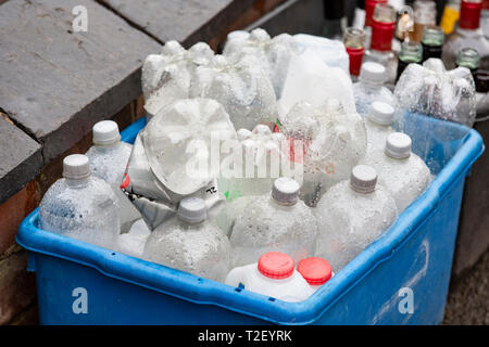 Plastic bottles left on the side of the road to be recycled in the UK - Stock Photo