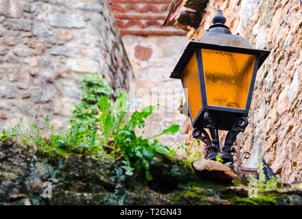 Photo centered on the charm of the lampposts forged in the town of Pals de Girona - Stock Photo