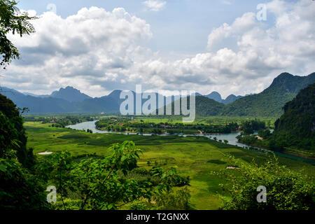 View of rice paddies and limestone mountines of Phongh Nha-Ke Bang National Park near Phong Nha, Vietnam. - Stock Photo