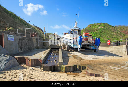 Local fishing boat and tractor off the beach on the access gangway on the North Norfolk coast at East Runton, Norfolk, England, UK, Europe. - Stock Photo
