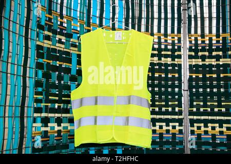 Yellow vest exhibited at the biennale of design. Saint Etienne, Loire, Auvergne Rhone Alpes. Saint-Etienne, FRANCE - 04/01/2019     Gilet jaune expose - Stock Photo