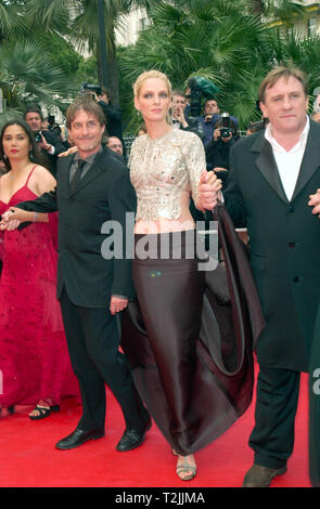 CANNES, FRANCE. May 10, 2000:  Actress Uma Thurman With Director Roland Joffe (left) & Actor Gerard Depardieu at the opening night gala screening of their movie Vatel at the Cannes Film Festival. Picture: Paul Smith/Featureflash - Stock Photo