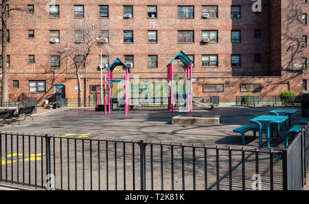 A children's playground in the massive NYCHA Elliot Houses complex of apartments in Chelsea in New York is seen on Saturday, March 30, 2019. (© Richard B. Levine) - Stock Photo
