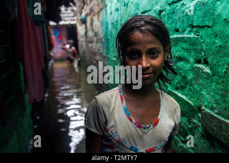 I took this picture few years ago in a narrow alley of Howrah, after a heavy rainfall. Their waterlogged condition was terrible to describe. - Stock Photo
