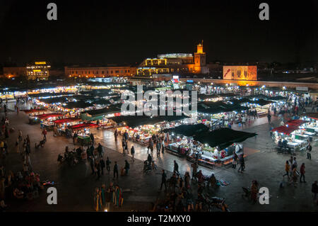 Traditional crowded market in Marrakech Morocco - Stock Photo