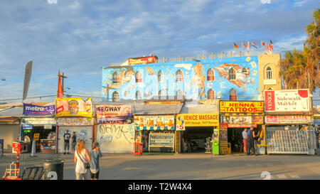 LOS ANGELES, CALIFORNIA, USA - AUGUST 25, 2015: wide shot of the vendors along the boardwalk at venice beach, los angeles - Stock Photo