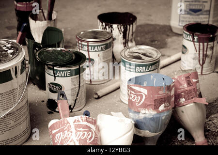 Cans and brushes of paint - Stock Photo