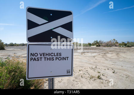 North Shore, California - March 23, 2019: Sign indicating a Desert X Art Installation exhibit and project is nearby. No vehicles allowed - Stock Photo