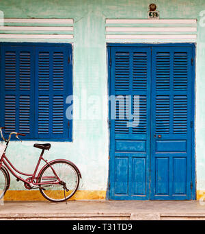 Bike Parked on a Front Porch - Stock Photo