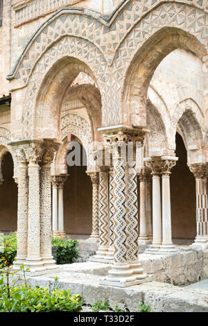 Cloisters columns and mosaics at cathedral Basilica Cattedrale Parrocchia Santa Maria Nuova in Monreale, Sicily - Stock Photo
