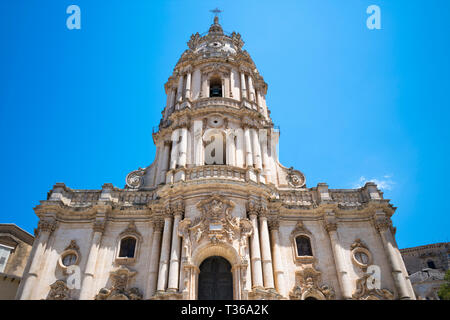 Front elevation and tower of of Baroque style Cathedral of San Giorgio in Modica Alta ancient city, South East Sicily - Stock Photo