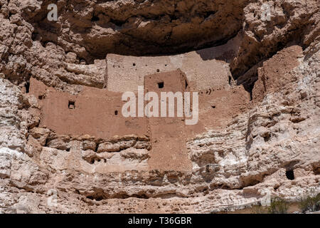 Montezuma Castle in Montezuma Castle National Monument is an example of a Pre-Columbian permanent dwelling carved in a limestone cliff. - Stock Photo