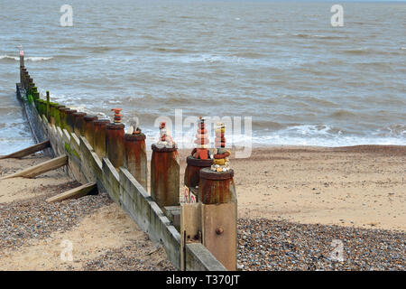Pebble towers on the wave breakers at Southwold Beach in Suffolk, UK - Stock Photo