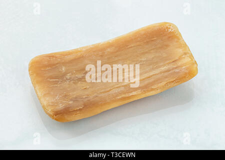natural organic laundry soap old. isolated on white background - Stock Photo