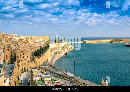 Valletta, Malta: View over Grand Harbor and the city of Valletta from Upper Barrakka Gardens - Stock Photo