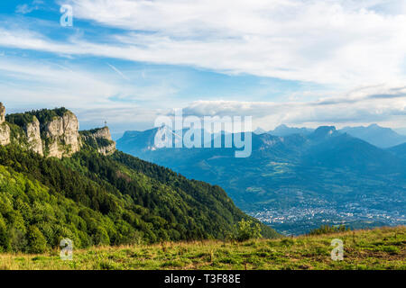 Les Deserts (Savoy, central-eastern France).  The Nivolet Cross and the city of Chambery viewed from the site of Le-Sire, near the ski resort of La Fe - Stock Photo