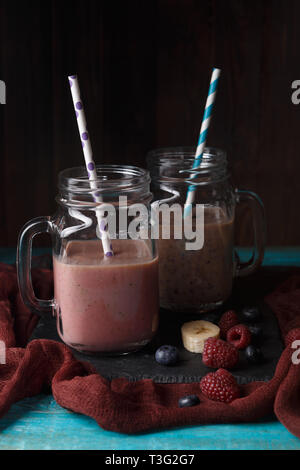 Image of two jars with smoothies on table - Stock Photo