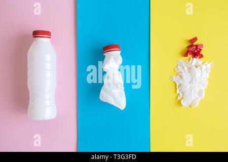 Flat lay of plastic bottle recycling stages on colorful pastel background minimal creative ecology concept. - Stock Photo