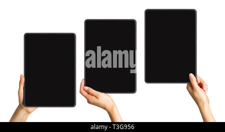 Set of mockups of black tablets in women's hands, concept of taking photo - Stock Photo