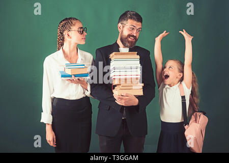 Back to school and home schooling. School time of sisters and father in library. Education in knowledge day. Literature lesson and reading grammar - Stock Photo
