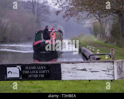 Hire boat entering lock - Stock Photo