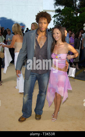 LOS ANGELES, CA. July 22, 2002: Actor GARY DOURDAN & girlfriend at the Hollywood premiere of Austin Powers in Goldmember. © Paul Smith / Featureflash - Stock Photo