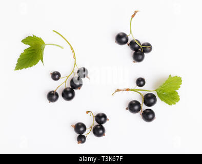 Fresh blueberries, red and black currants, gooseberries, summer berry ornament on a white background - Stock Photo