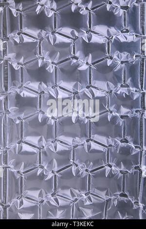 Air cushion bag of packaging isolated on white. Transparent bubble wrap packing background, cellophane film,  protective package with air - Stock Photo