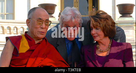 Washington DC, USA, October 17, 2007   His Holiness The  14th Dalia Lama Lhamo Dondrub of Tibet Presides over event on West Front of the US Capitol. With him are actor Richard Gere and Speaker of the House Nancy Pelosi (D) Ca. - Stock Photo