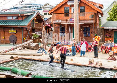 Log rolling demonstration at the Great Alaskan Lumberjack Show in Ketchikan, Alaska USA - Stock Photo
