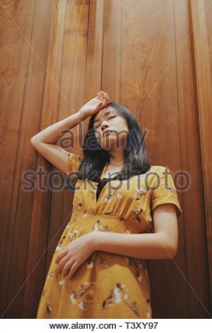 woman lining on wall - Stock Photo