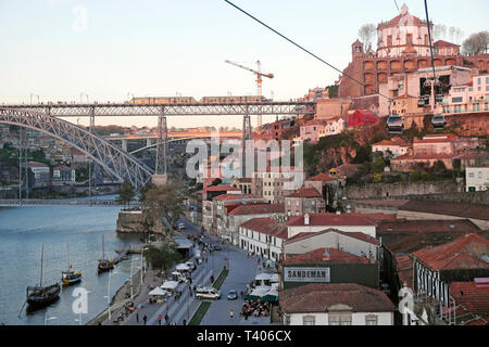 View of train on Dom Luis I Bridge from Aerial cable car Teleférico Vila Nova de Gaia in Porto Portugal Europe EU    KATHY DEWITT - Stock Photo
