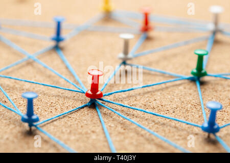 Business team. Connect between people. Office pins tied with blue thread. - Stock Photo