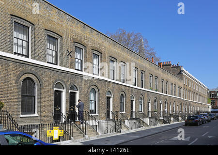 A row of original Victorian terraced cottages on Falmouth Street, London, UK. - Stock Photo
