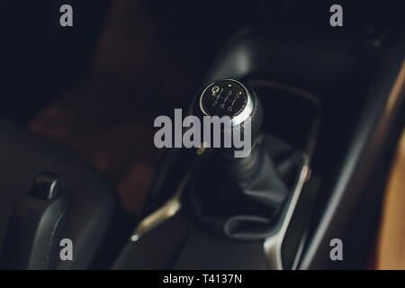 Close up view of a gear lever shift. Manual gearbox. Car interior details. Car transmission. Soft lighting. Abstract view. - Stock Photo