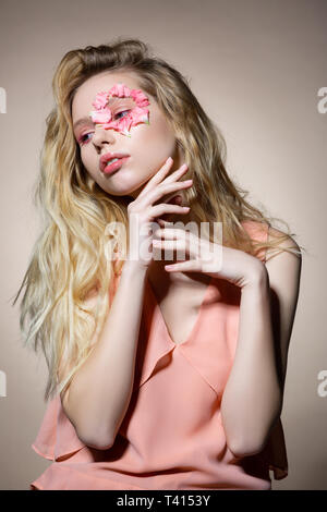 Tender model with flower petals around eye feeling amazing - Stock Photo