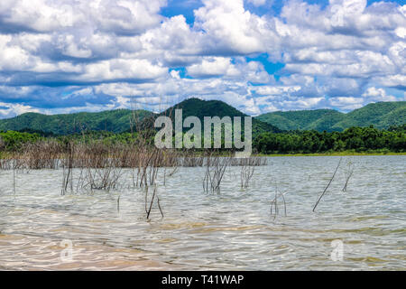 This unique picture shows the beautiful nature with hills and trees and the great reservoir in the Kaeng Krachan National Park in Thailand - Stock Photo