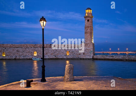 The beautiful lighthouse at the old port of Rethimno town, Crete, Greece. - Stock Photo